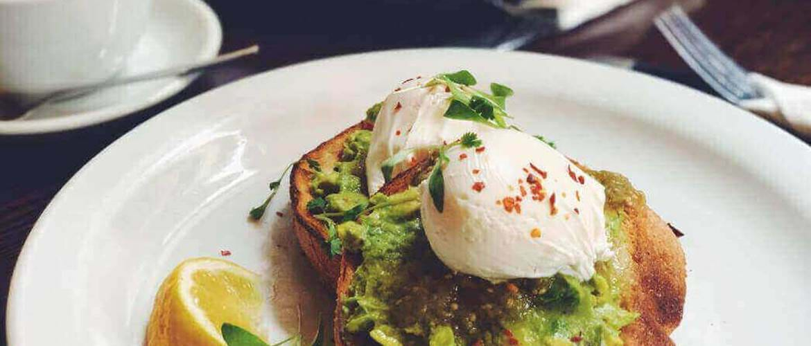 Avocado and poached eggs at Moose Coffee
